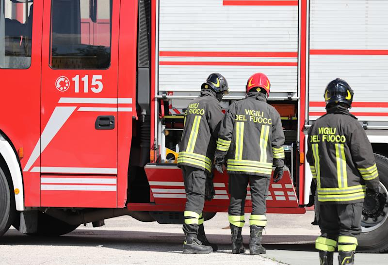 Rome, Italy - May 16, 2019: Italian firefighters in action with the fire truck during an emergency to extinguish a fire