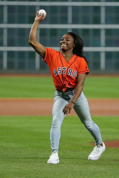 PHOTO:Olympic gymnastics gold medalist Simone Biles throws out a ceremonial first pitch prior to game two of the 2019 World Series between the Houston Astros and the Washington Nationals at Minute Maid Park, OCt. 23, 2019. (Troy Taormina/USA TODAY Sports via Reuters)