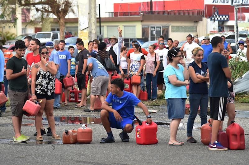 People wait in line to purchase gas in Arecibo, northwestern Puerto Rico, in the aftermath of Hurricane Maria on Sept. 22, 2017.