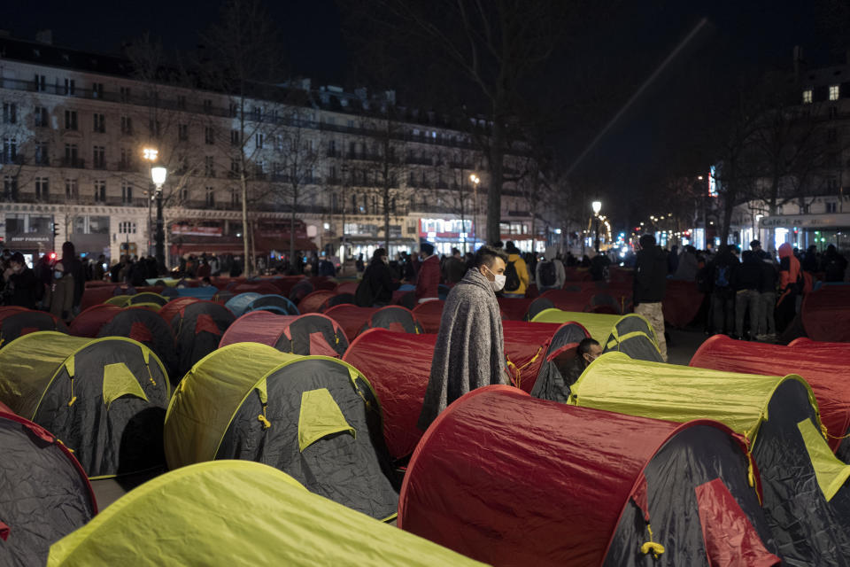 Migrants set up tents in the Place de la République square to draw attention to their living conditions and to demand accommodation, in Paris, Thursday, March 25, 2021. (AP Photo/Rafael Yaghobzadeh)
