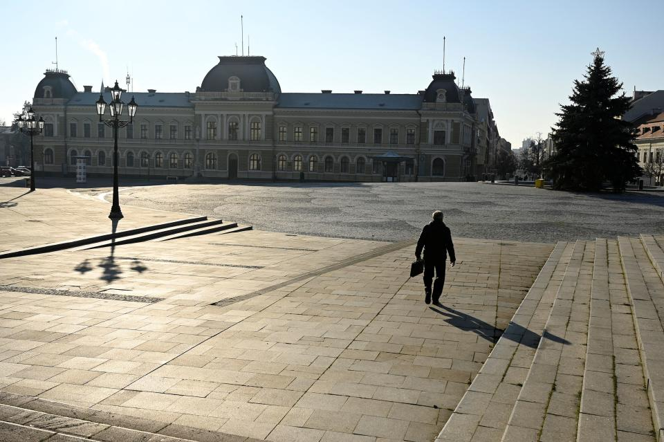 A man walks through the empty downtown, amid the spread of the coronavirus disease (COVID-19),  in Nitra, Slovakia January 11, 2021. REUTERS/Radovan Stoklasa