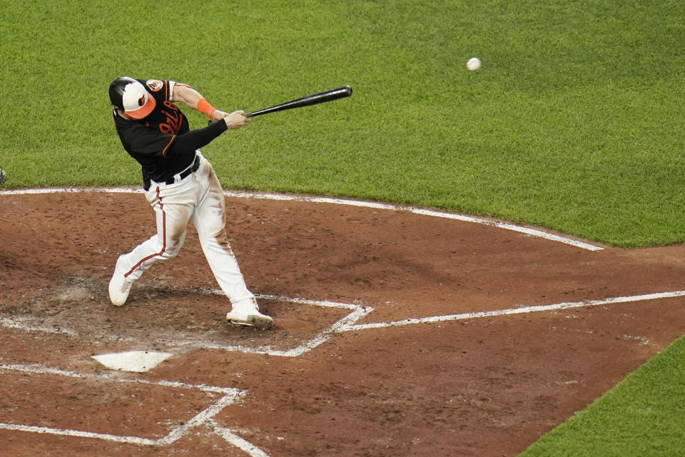 Baltimore Orioles' Austin Hays hits an RBI single to left field to score Pat Valaika during the fifth inning of a baseball game against the Toronto Blue Jays, Friday, June 18, 2021, in Baltimore. (AP Photo/Julio Cortez)