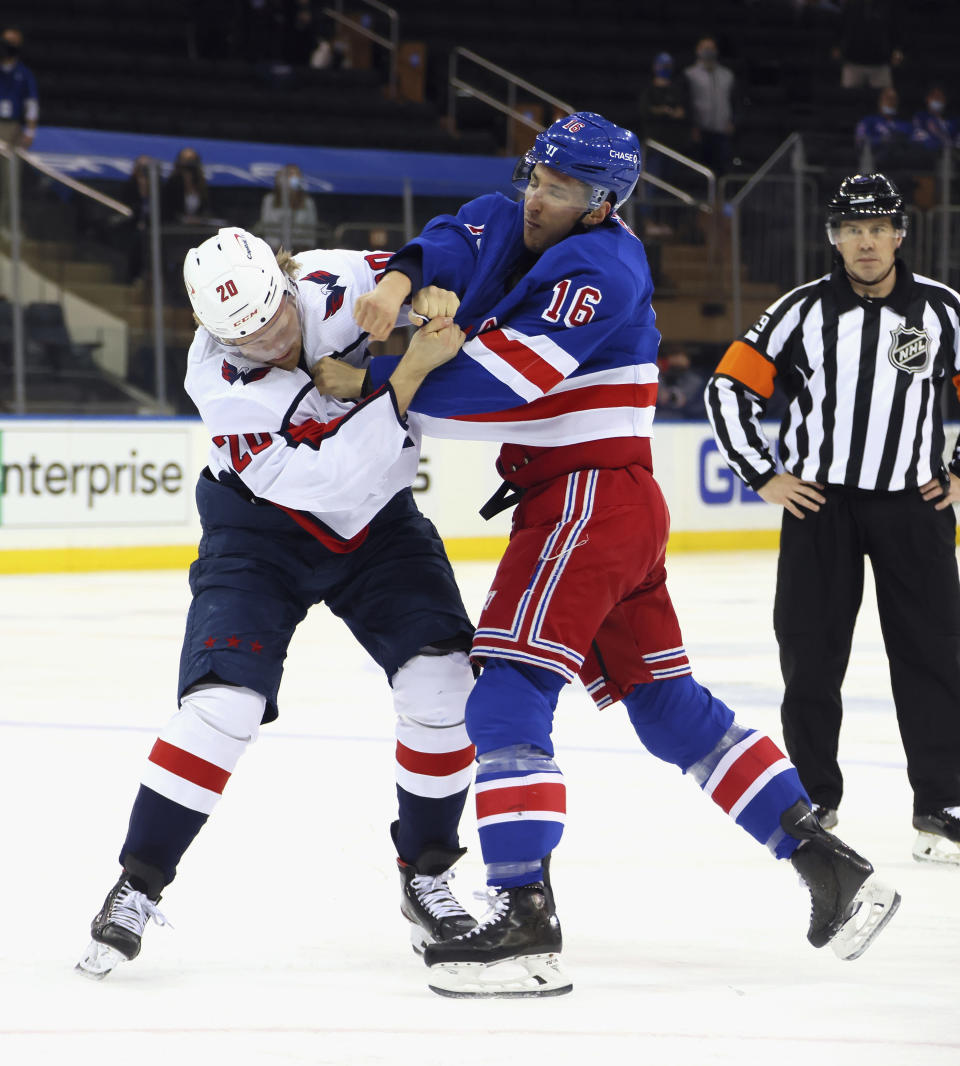 New York Rangers' Ryan Strome (16) fights with Washington Capitals' Lars Eller (20) during the first period of an NHL hockey game Wednesday, May 5, 2021, in New York. (Bruce Bennett/Pool Photo via AP)
