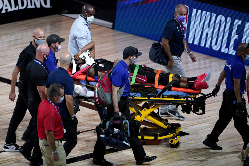 Miami Heat's Derrick Jones Jr is carried off the court on a stretcher after being injured against the Indiana Pacers during the second half of an NBA basketball game Monday, Aug. 3, 2020, in Lake Buena Vista, Fla. (AP Photo/Ashley Landis, Pool)