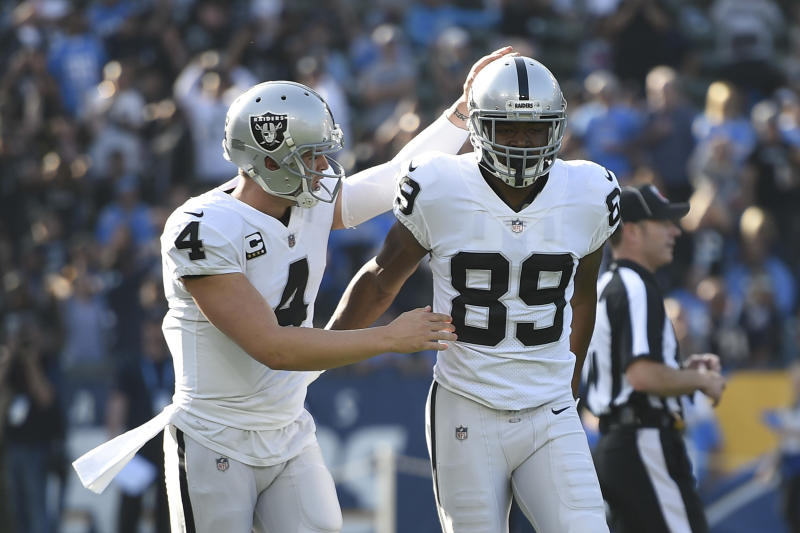 The duo of Raiders quarterback Derek Carr (L) and wide receiver Amari Cooper struggled this season. (AP)