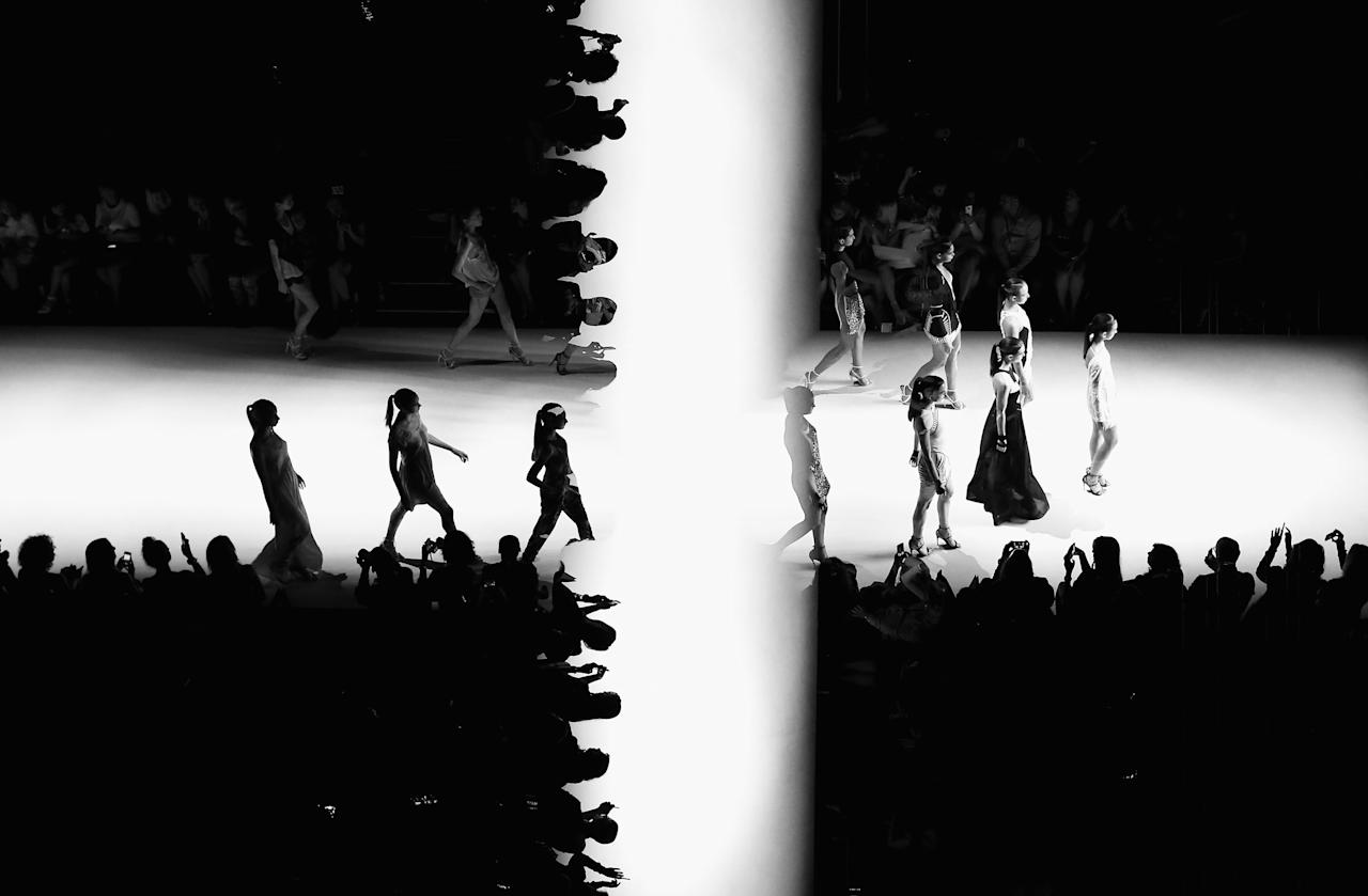 SYDNEY, AUSTRALIA - APRIL 11: (EDITORS NOTE: Multiple exposures were combined in camera to produce this image. This digital image has been converted to black and white) Models showcase designs on the runway at the Bless'ed Are The Meek show during Mercedes-Benz Fashion Week Australia Spring/Summer 2013/14 at Carriageworks on April 11, 2013 in Sydney, Australia.  (Photo by Ryan Pierse/Getty Images)