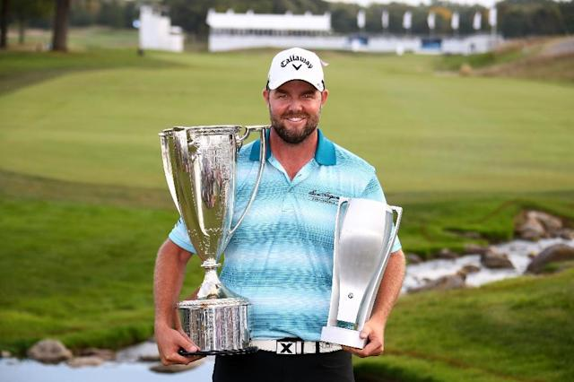 Marc Leishman of Australia poses with the Wadley Cup and the BMW Championship Trophy after winning the BMW Championship, at Conway Farms Golf Club in Lake Forest, Illinois, on September 17, 2017 (AFP Photo/Gregory Shamus)