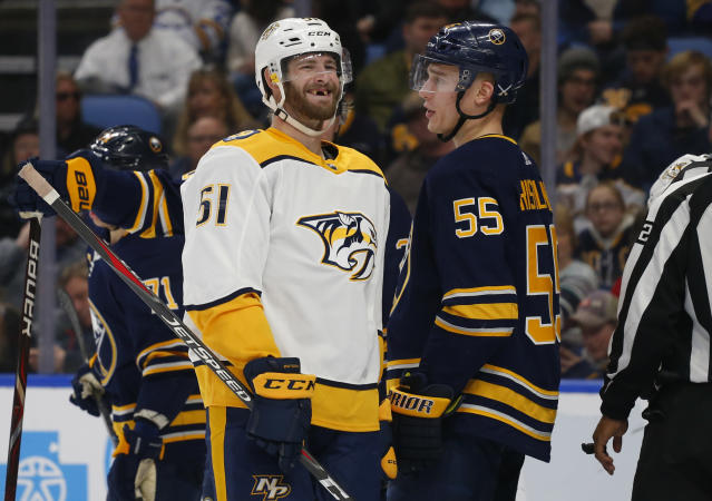 Buffalo Sabres defenseman Rasmus Ristolainen (55) and Nashville Predators forward Austin Watson (51) exchange words during the second period of an NHL hockey game Tuesday, April 2, 2019, in Buffalo, N.Y. (AP Photo/Jeffrey T. Barnes)