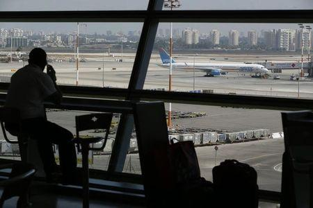 A passenger looks out of a window at Ben Gurion International airport