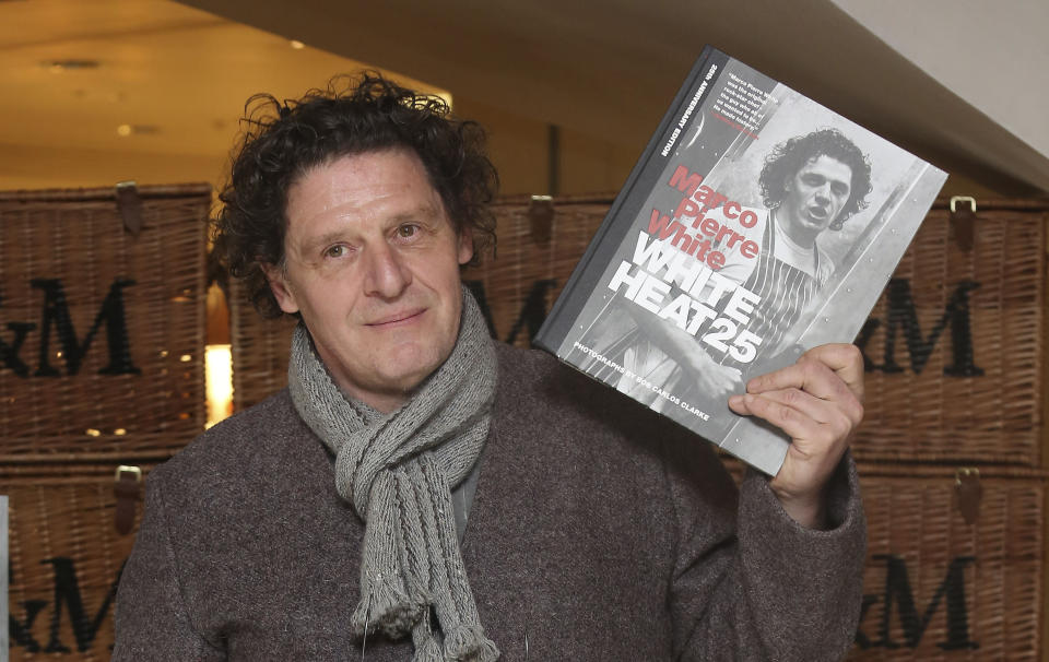 Marco Pierre White at Fortnum & Mason in London, signing his new book White Heat 25, a 25th anniversary edition of his classic cookbook, White Heat.