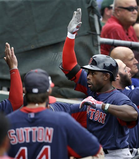 Boston Red Sox Drew Sutton (44) greets teammate Jackie Bradley Jr. at the dugout steps after Bradley Jr. hit a second-inning, three-run, home run off Philadelphia Phillies starting pitcher Cliff Lee in a spring training baseball game in Clearwater, Fla., Sunday, March 24, 2013. (AP Photo/Kathy Willens)
