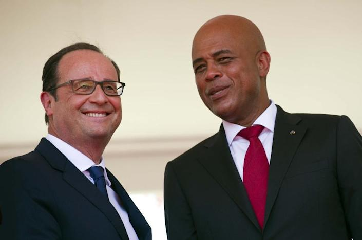 Haiti President Michel Martelly (right), pictured with French President Francois Hollande, is constitutionally barred from seeking a second term in office (AFP Photo/Hector Retamal)