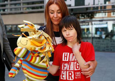 FILE PHOTO: Charlotte Caldwell, and her son Billy, stand outside the Home Office during a break in a meeting with officials to discuss how Billy can have his severe epilepsy treated with cannabis oil, which is a banned substance in Britain, in London