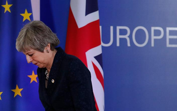 British Prime Minister Theresa May leaves after addressing a media conference at an EU summit in Brussels, Friday, March 22, 2019. (Photo: Frank Augstein/AP)