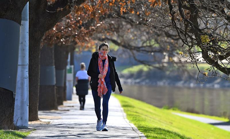 A woman exercises alongside the Yarra River in Melbourne this month during lockdown. Source: Getty