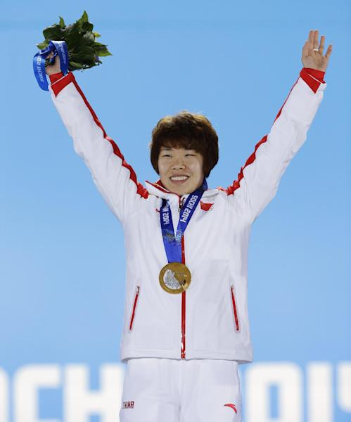 Women's 1,500-meter short track speedskating gold medalist Zhou Yang of China gestures while standing on the podium during the medals ceremony at the 2014 Winter Olympics, Saturday, Feb. 15, 2014, in Sochi, Russia. (AP Photo/David J. Phillip )