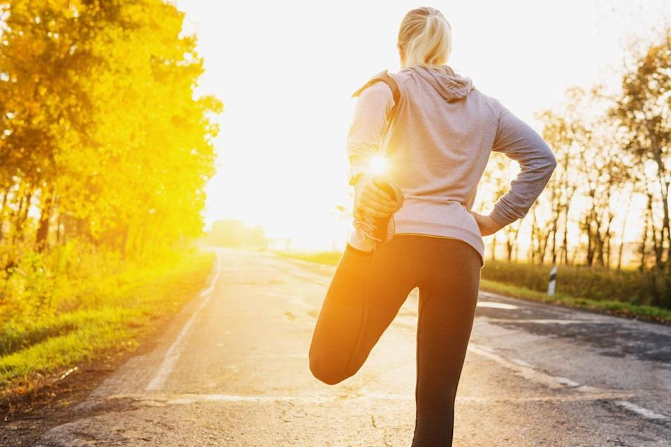 Fitness woman runner stretching legs
