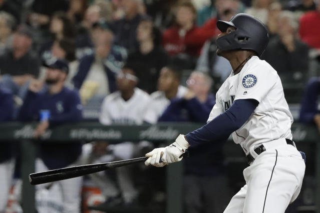 Seattle Mariners' Kyle Lewis watches his three-run home run against the Cincinnati Reds during the seventh inning of a baseball game Wednesday, Sept. 11, 2019, in Seattle. Lewis ended a no-hit bid by Reds starting pitcher Sonny Gray. (AP Photo/Ted S. Warren)