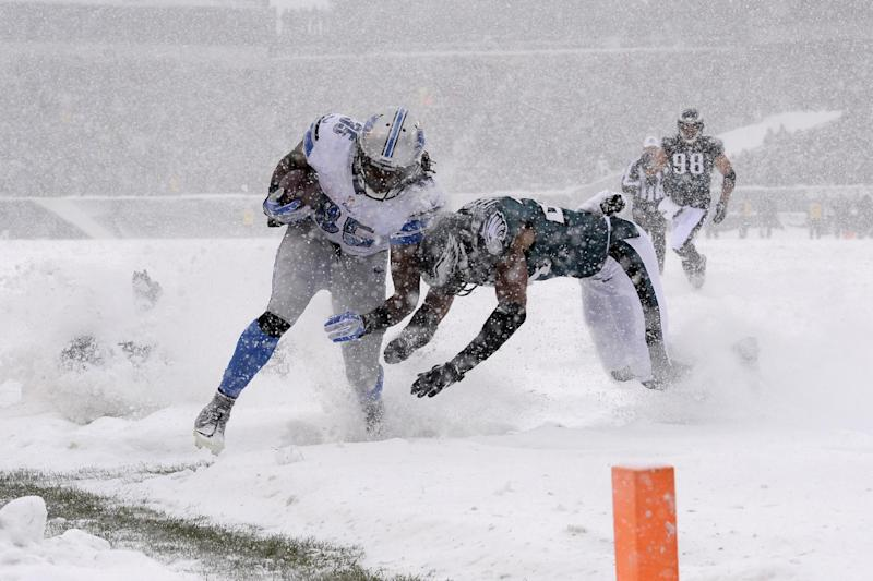 Detroit Lions' Joique Bell, left, is tackled by Philadelphia Eagles' Bradley Fletcher during the first half of an NFL football game, Sunday, Dec. 8, 2013, in Philadelphia. (AP Photo/Michael Perez)