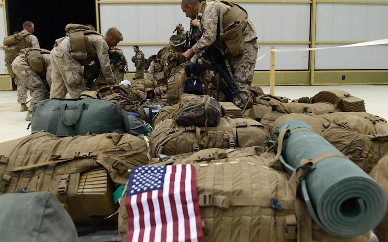US marines, in a file photo showing deployment in Afghanistan in 2014 - AFP or licensors