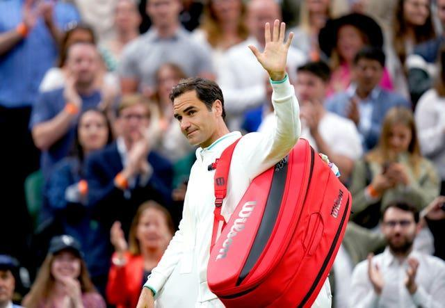 Roger Federer waves to the Centre Court crowd