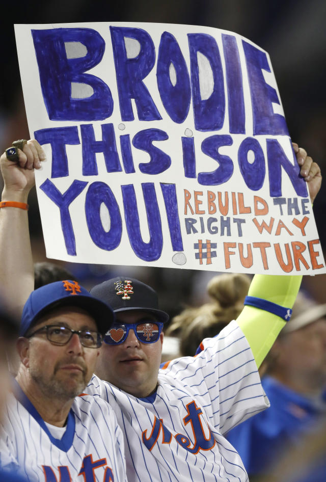 Disgruntled New York Mets fans express their sentiments with a sign for Mets general manager Brodie Van Wagenen during a baseball game against the Atlanta Braves, Sunday, June 30, 2019, in New York. (AP Photo/Kathy Willens)