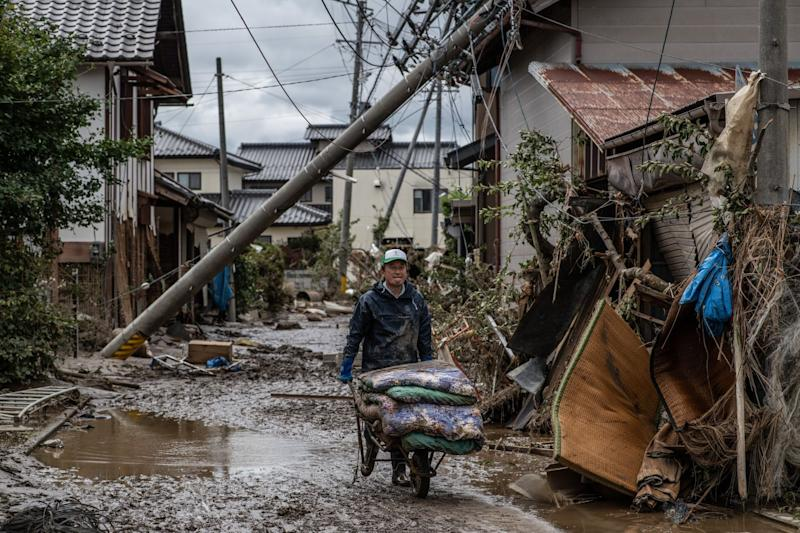 Japan Braces for Double Disaster of Covid Outbreaks at Flooding Shelters