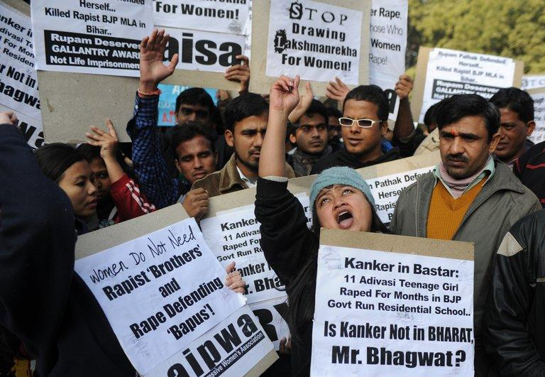 Indian students shout slogans against spiritual guru Asharam, who said the victim of a gang-rape last month could have averted the crime by begging for mercy, during a protest in New Delhi on January 8, 2013. Two of the five men accused of gang-raping and murdering a 23-year-old woman in a moving bus in New Delhi last month will plead not guilty to all charges, a lawyer said Tuesday
