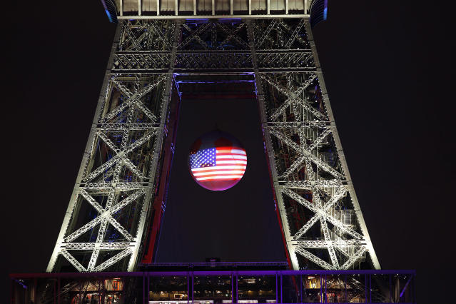 <p>The U.S. flag is projected on a giant soccer ball at the Eiffel Tower in Paris on June 13, 2016, to pay tribute to victims of a shooting inside a gay nightclub, Pulse Club in Orlando. (Photo: Chesnot/Getty Images) </p>