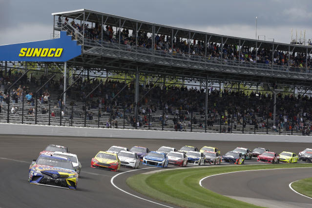 NASCAR Cup Series driver Kyle Busch (18) leads the first lap during the NASCAR Brickyard 400 auto race at Indianapolis Motor Speedway, in Indianapolis Monday, Sept. 10, 2018. (AP Photo/AJ Mast)
