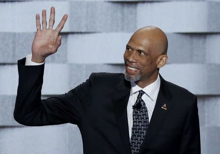 NBA basketball Hall of Famer Abdul-Jabaar waves before speaking on the final night of the Democratic National Convention in Philadelphia