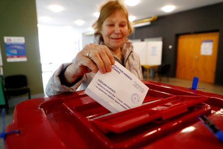 A woman casts her vote during European Parliament election in Riga, Latvia, May 25, 2019. REUTERS/Ints Kalnins