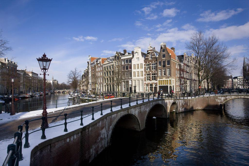 General view of the canals in Amsterdam, Netherlands. Amsterdam with its many canals and bridges, often referred to as the Venice of the North, is the country's tourist and financial capital.
