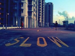 SLOW sign in front of flats