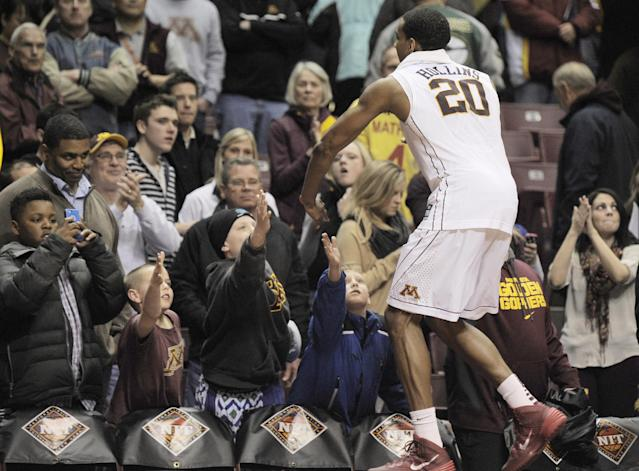 Minnesota fans congratulate Minnesota's Austin Hollins (20) as he leaves the court after Minnesota beat Southern Mississippi 81-73 in an NCAA college basketball game in the third round of the National Invitational Tournament in Minneapolis, Tuesday, March 25, 2014. Hollins finished with a game-high 32 points.(AP Photo/Tom Olmscheid)