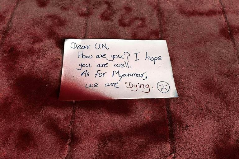 "Protesters spray-painted pavements red in a Yangon suburb and left a note that read: ""Dear UN, How are you. I hope you are well. As for Myanmar, we are dying."""