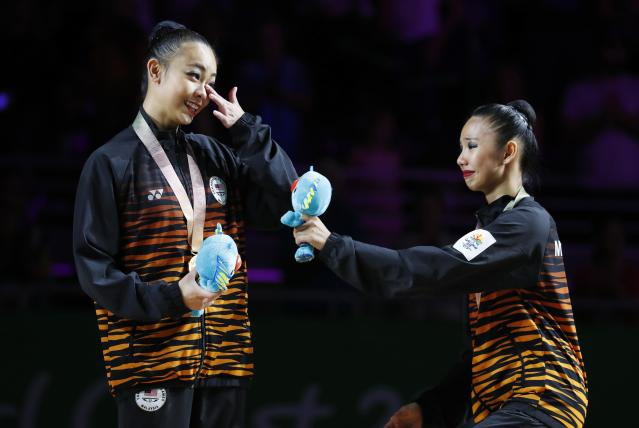 Rhythmic Gymnastics - Gold Coast 2018 Commonwealth Games - Individual Ribbon Final - Coomera Indoor Sports Centre - Gold Coast, Australia - April 13, 2018. Gold medallist Kwan Dict Weng (L) of Malaysia and bronze medallist Koi Sie Yan of Malaysia. REUTERS/David Gray
