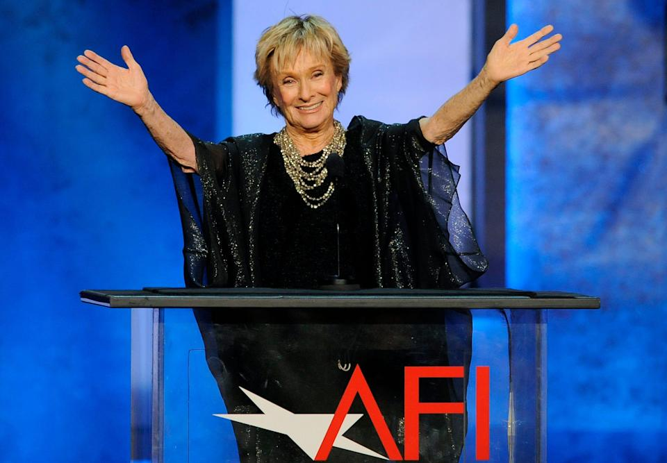 """Actress Cloris Leachman gestures to honoree Mel Brooks in the audience during the American Film Institute's 41st Lifetime Achievement Award Gala on June 6, 2013, in Los Angeles. Leachman, a character actor whose depth of talent brought her an Oscar for the """"The Last Picture Show"""" and Emmys for her comedic work in """"The Mary Tyler Moore Show"""" and other TV series, has died. She was 94."""