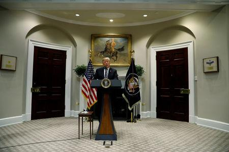 FILE PHOTO: U.S. President Donald Trump delivers remarks on immigration and border security in the Roosevelt Room of the White House in Washington, U.S., November 1, 2018. REUTERS/Kevin Lamarque/File Photo