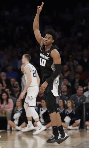 Providence's A.J. Reeves (10) reacts after making a 3-point basket during the first half of an NCAA college basketball game against Villanova in the Big East conference tournament, Thursday, March 14, 2019, in New York. (AP Photo/Frank Franklin II)