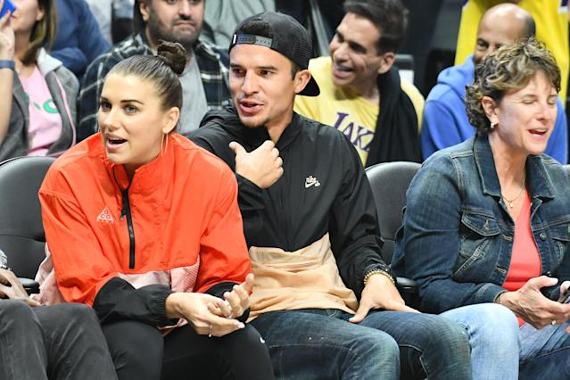 "Alex Morgan and Servando Carrasco were at the <a class=""link rapid-noclick-resp"" href=""/nba/teams/la-clippers/"" data-ylk=""slk:Los Angeles Clippers"">Los Angeles Clippers</a> and the <a class=""link rapid-noclick-resp"" href=""/nba/teams/la-lakers/"" data-ylk=""slk:Los Angeles Lakers"">Los Angeles Lakers</a> at Staples Center Tuesday night. Wednesday, they announced they are expecting their first child. (Getty Images)"