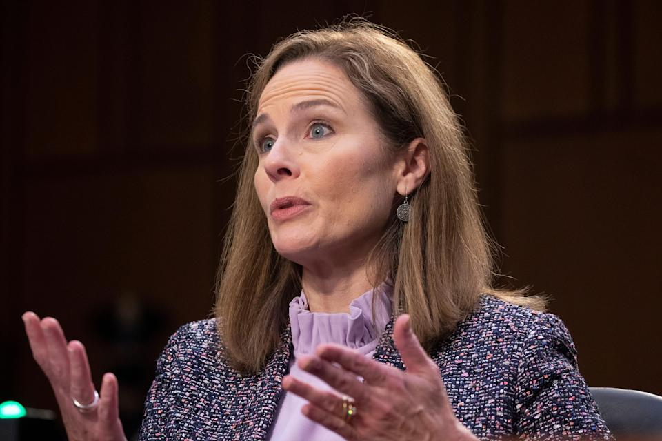 Supreme Court nominee Amy Coney Barrett testifies before the Senate Judiciary Committee on the third day of her confirmation hearing on Capitol Hill on Oct. 14.