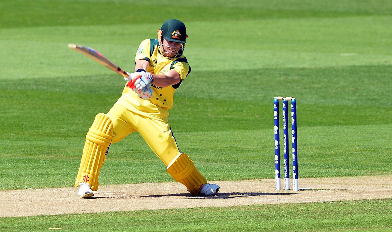 Australia's David Warner plays a shot during the warm-up cricket match ahead of the 2013 ICC Champions Trophy between India and Australia at The Cardiff Wales Stadium in Cardiff, Wales on June 4, 2013.  India won by 243 runs. AFP PHOTO/Paul ELLIS        (Photo credit should read PAUL ELLIS/AFP/Getty Images)