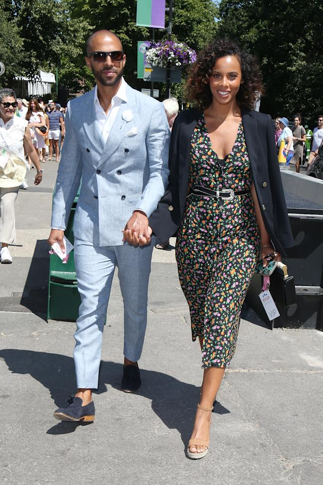 <p>Marvin Humes opted for a powder blue double-breasted suit to kick-start Wimbledon 2018 while Rochelle draped a blazer over her floral number. <em>[Photo: Rex]</em> </p>