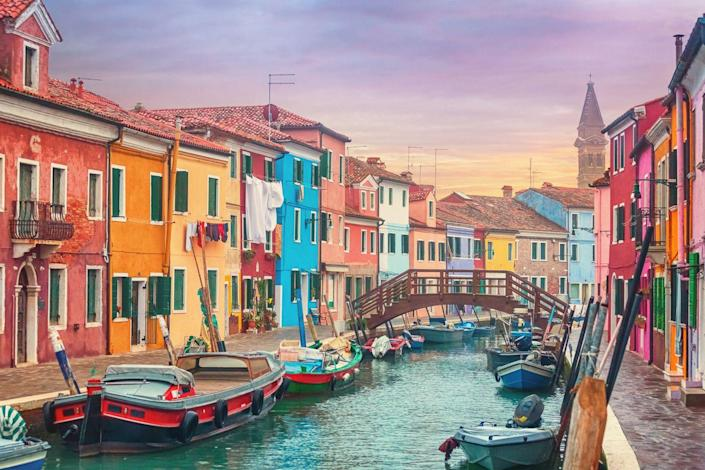 <p>Dodge the crowds in Venice by heading to the colorful Venetian island of Burano. Similarly romantic canals snake their way between back streets and town centers and vibrant buildings abound. It's known for its homemade lace. You can easily do it for a day if you're already in Venice. </p>