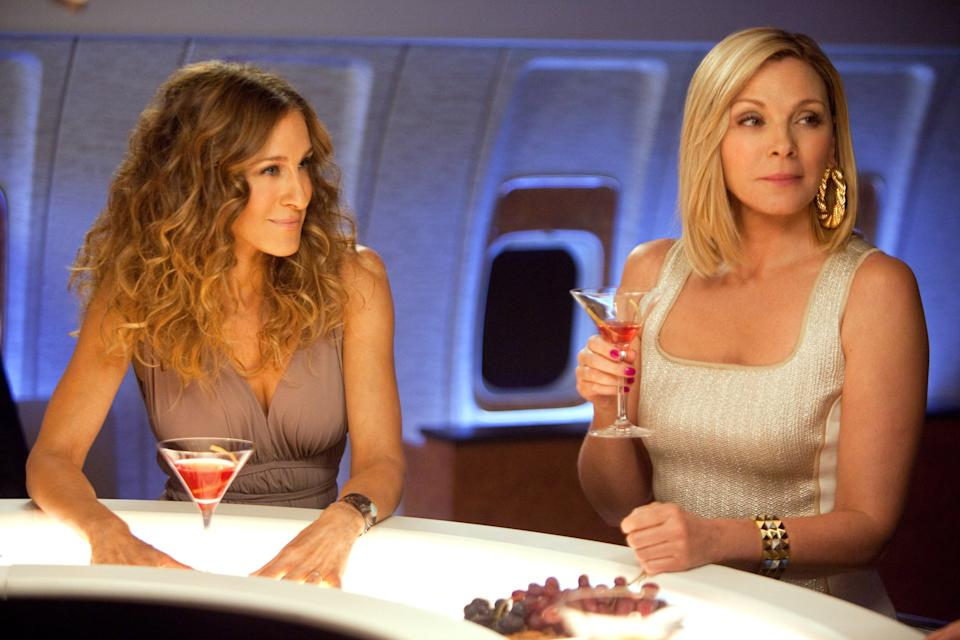Kim Cattrall and Sarah Jessica Parker at a bar on a plane