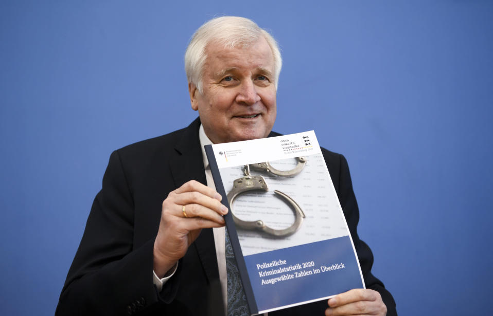 German Interior Minister Horst Seehofer presents the crime statistics report for 2020 during a news conference in Berlin, Germany, Thursday, April 15, 2021. (Annegret Hilse/Pool via AP)