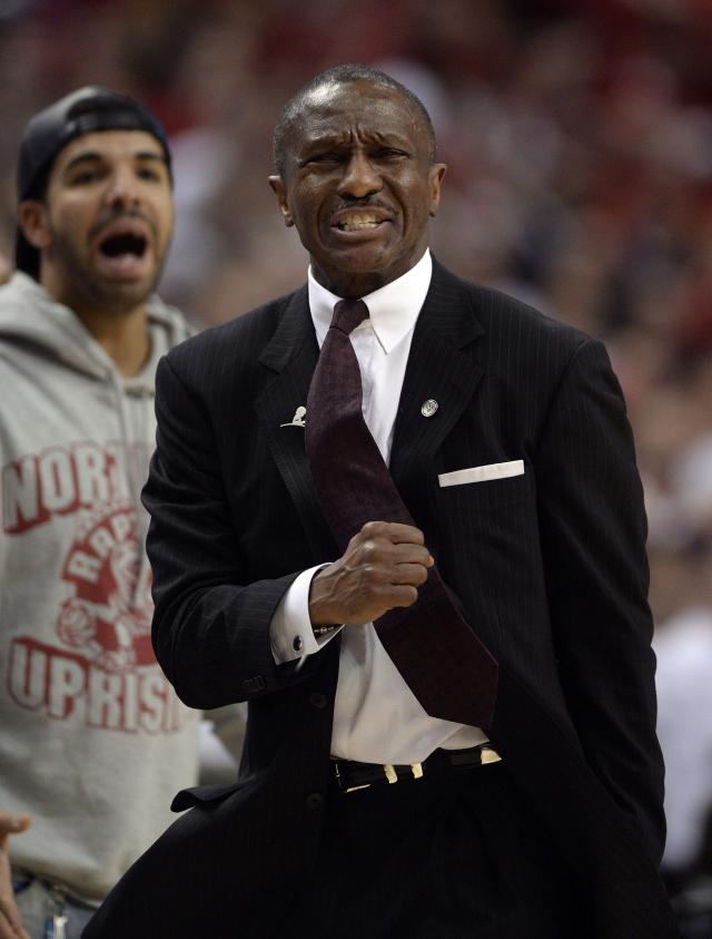 Toronto Raptors head coach Dwane Casey, right, and rapper Drake react near the end of a loss to the Brooklyn Nets in Game 7 of the opening-round NBA basketball playoff series in Toronto, Sunday, May 4, 2014. (AP Photo/The Canadian Press, Frank Gunn)