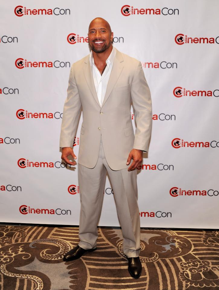 "LAS VEGAS, NV - APRIL 23:  Actor Dwayne Johnson, recipient of the Action Star of the Decade Award, arrives at a Paramount Pictures and DreamWorks Animation event at Caesars Palace during the opening night of CinemaCon, the official convention of the National Association of Theatre Owners, April 23, 2012 in Las Vegas, Nevada. Johnson is promoting his upcoming movie, ""G.I. Joe: Retaliation.""  (Photo by Ethan Miller/Getty Images)"