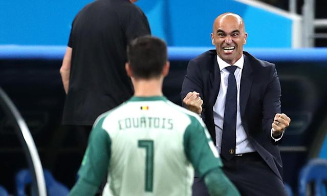 Roberto Martínez celebrates with his goalkeeper Thibaut Courtois after Belgium's late winner.
